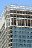Modern building under construction. A modern building is in construction working status, the external wall shown as color in blue and shape in geometrical Stock Photos