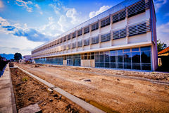 Modern building under construction and works on the road Royalty Free Stock Photo