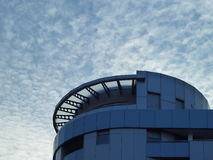 Modern building under the sky with clouds. Modern building under the blue sky with clouds stock image