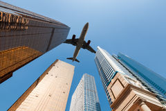 Modern building underneath airplane. Abstract cityscape in guangzhou Royalty Free Stock Photography