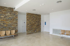 Modern building waiting area with chairs Royalty Free Stock Photos