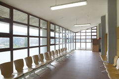 Modern building waiting area with wooden seats Stock Images