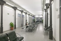 Modern building waiting room with metallic chairs Stock Photography
