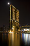 Modern building on water at night Royalty Free Stock Photography