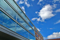 Modern Building wih blue sky. A modern commercial building with a bright sunny sky reflected in the windows Royalty Free Stock Images