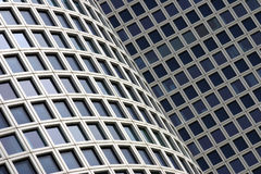 Modern building windows. A creative view of rows of windows on the sides of two modern office buildings Royalty Free Stock Photography