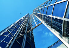 Modern building in Zagreb, Croatia. Beautiful blue scene with bird, sky and glass windows of a modern building in Zagreb, Croatia royalty free stock photos