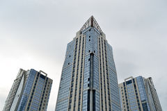 Modern buildings. Against the background of the cloudy sky Stock Photography