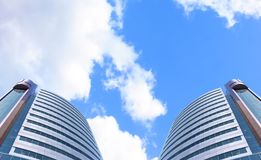 Modern buildings. Photo of a modern buildings of large banks on a background of the clouds sky Stock Photography