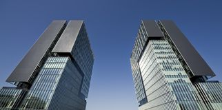 Modern buildings. Urban view at modern glass building with blue sky Stock Photo