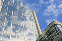 Modern buildings. Low angle shot of sky reflected in modern buildings stock image