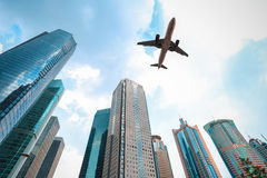 Modern buildings with airplane Royalty Free Stock Photography