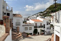 Modern buildings along narrow street in Frigiliana - Spanish white village Andalusia Stock Images