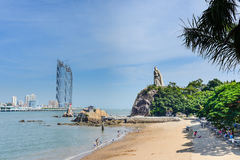 Modern buildings and ancient statues on the bay.  stock photos