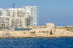 Modern buildings in the area of Marsamxett Harbour. Valletta, Malta - November 8, 2015: Construction of modern buildings close to old fortifications of Order of Stock Image
