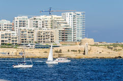 Modern buildings in the area of Marsamxett Harbour. Valletta, Malta - November 8, 2015: Construction of modern buildings close to old fortifications of Order of Royalty Free Stock Images