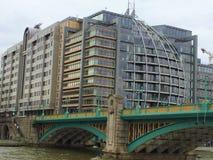 Modern buildings on the banks of Thames river. Modern office buildings on the banks of Thames river by Southwark Bridge - London, UK royalty free stock photo
