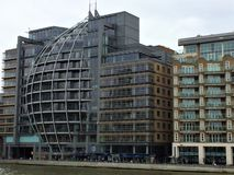 Modern buildings on the banks of Thames river. Modern office buildings on the banks of Thames river- London, UK stock photography