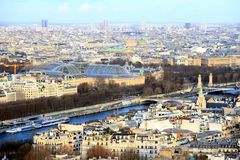Aerial view of River Seine and Bateaux Mouches in Paris. Modern buildings and bateaux mouches docked in the sides of the River Seine viewed from the top of Royalty Free Stock Image