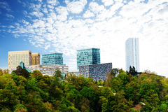 Modern buildings with beautiful sky in Luxembourg. Modern buildings with beautiful sky and clouds in Luxembourg surrounded by forest Royalty Free Stock Photos