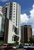 Modern buildings and a blue clouded clear sky. Buildings located in the city of Guatemala with a modern architecture look with a clouded blue sky behind them and stock photography