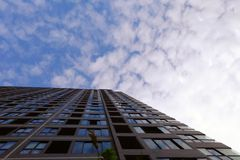 Modern Buildings and Blue Sky with Clouds Background Royalty Free Stock Photo