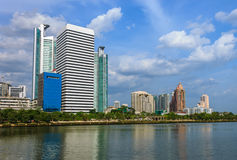 Modern buildings. On blue sky with lake Stock Images