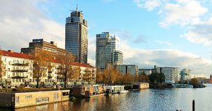 Modern buildings and boathouses at the amstel  river in Holland Royalty Free Stock Image
