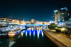 Modern buildings and boats along the Danube Canal at night, in V Royalty Free Stock Photography