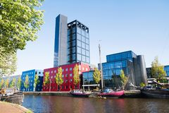 Modern buildings in bright colors are seen along a canal in the Netherlands. An array of modern and colorful buildings are seen across a canal in Leeuwarden the royalty free stock photo