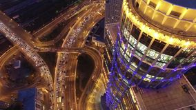 Modern buildings capital of Russia. Road traffic from above. Sunset evening night illumination. Light windows. Begovaya metro. Aerial quadcopter flight. 4K stock video