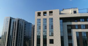A modern building, a building with panoramic windows, a modern high-rise building with a drone. Modern buildings in the center of the old city, top view, sunset stock footage