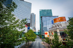 Modern buildings and College Street, in Uptown Charlotte, North. Carolina Stock Photography