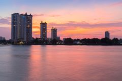 Modern buildings condominium at Chao Phraya River Bangkok Thailand at sunrise stock photos