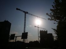 Modern buildings and cranes Royalty Free Stock Images
