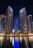 Modern buildings in district area Dubai Marina at night, UAE Stock Photography