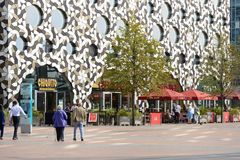 Modern buildings at Docklands in London, England. Modern buildings on the Greenwich Peninsular at Docklands in London. England. With people and terrace cafe Stock Image