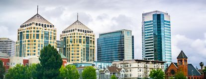 Modern buildings in downtown Oakland rising behind old ones; cloudy spring day; San Francisco bay area, California royalty free stock image