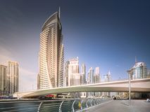 Day view of Dubai Marina bay with bridge, UAE. Modern buildings of Dubai Marina bay with bridge day view, UAE Stock Photos