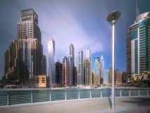 Day view of Dubai Marina bay with cloudy sky, UAE. Modern buildings of Dubai Marina bay with cloudy sky during sunny day, UAE Royalty Free Stock Image