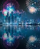 Dubai Marina bay view from Palm Jumeirah, UAE. Modern buildings on Dubai Marina bay at night with fireworks and reflection on water, UAE stock images