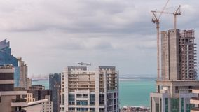 Modern buildings on Dubai Marina and JBR with construction site aerial timelapse in Dubai, United Arab Emirates. Modern buildings on Dubai Marina and JBR with stock video footage