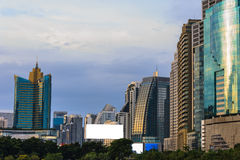 Modern buildings. At evening on blue sky background Stock Photos