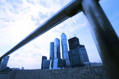Modern buildings in evening Moscow. Evening type of skyscrapers of the Moscow from under quay banisters Stock Image