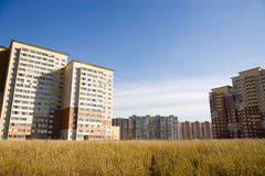 Modern buildings in a field Royalty Free Stock Images