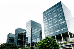 Modern buildings. Four glass modern buildings over pure white sky. Copyspace at the top royalty free stock image