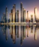 Dubai Marina bay view from Palm Jumeirah, UAE. Modern buildings with gold reflection of sunset on Dubai Marina bay view from Palm Jumeirah, UAE Stock Photography