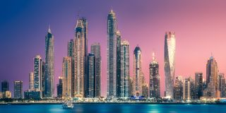 Dubai Marina bay view from Palm Jumeirah, UAE. Modern buildings with gold reflection of sunset on Dubai Marina bay view from Palm Jumeirah, UAE royalty free stock images