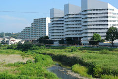 Modern Buildings Hachoji Japan. Modern buildings near a flood plain in the city of Hachoji Japan in the early morning hours Stock Photo
