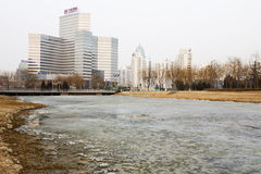 Modern Buildings and an Icy River in Beijing Royalty Free Stock Images